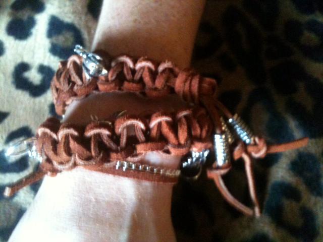 3 x brown sureded charm bracelet on human hand.jpg