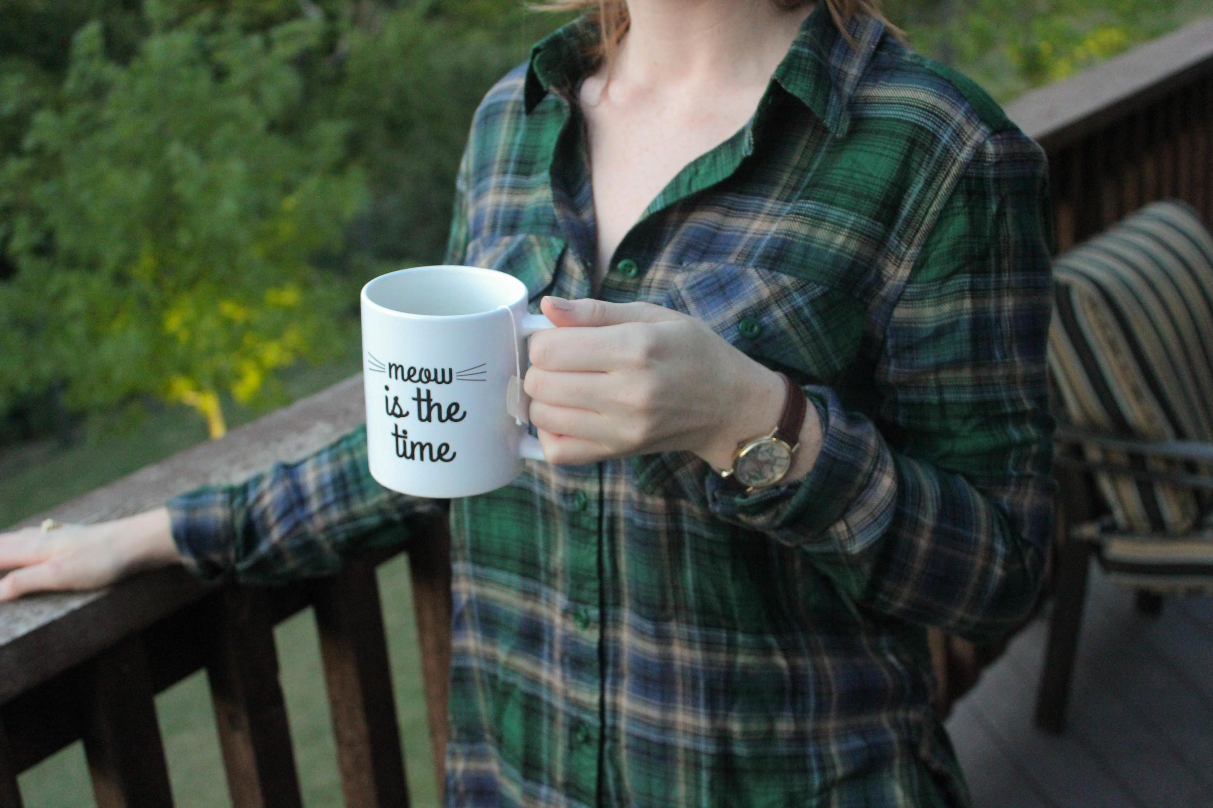 green plaid flannel, tea mug, map watch