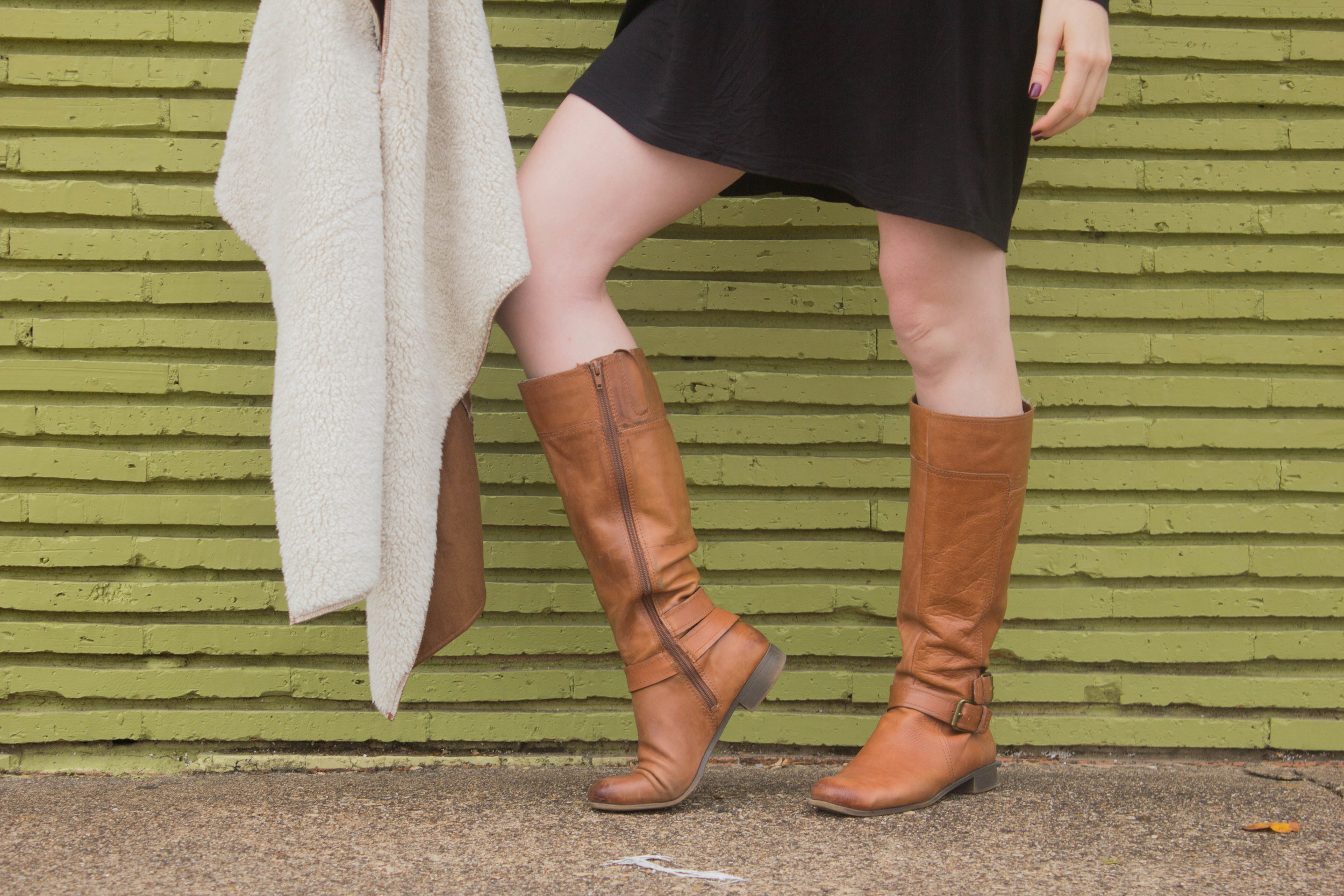 shearling vest, riding boots, piko tunic