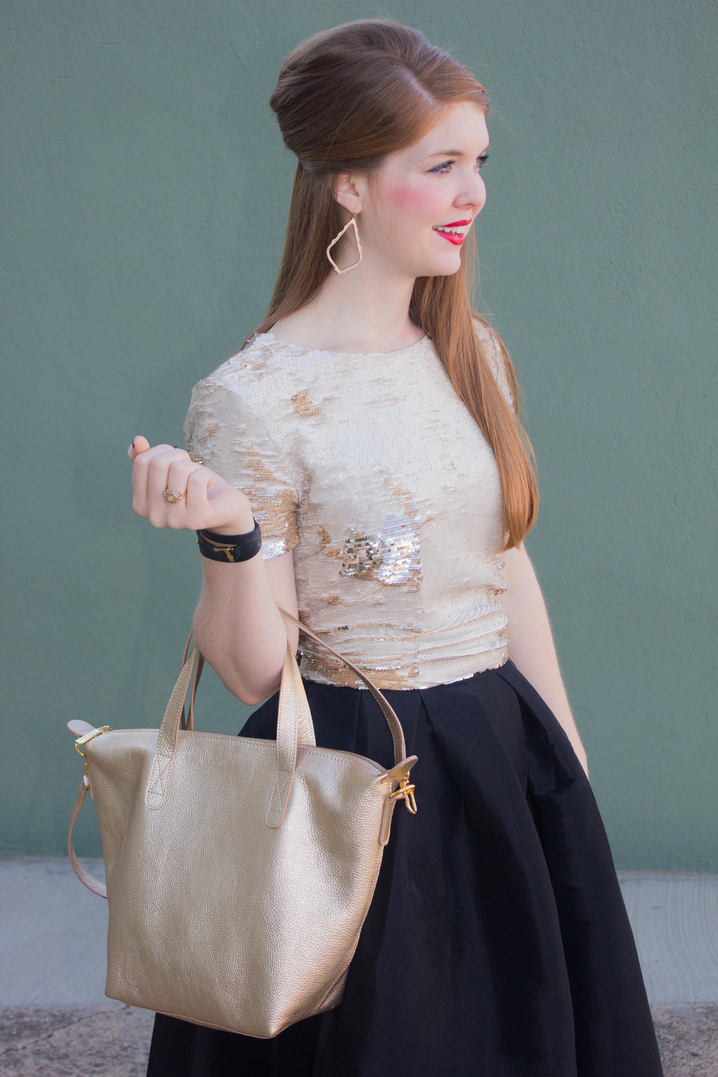 pleated black midi skirt, sequin top, cuyana carryall