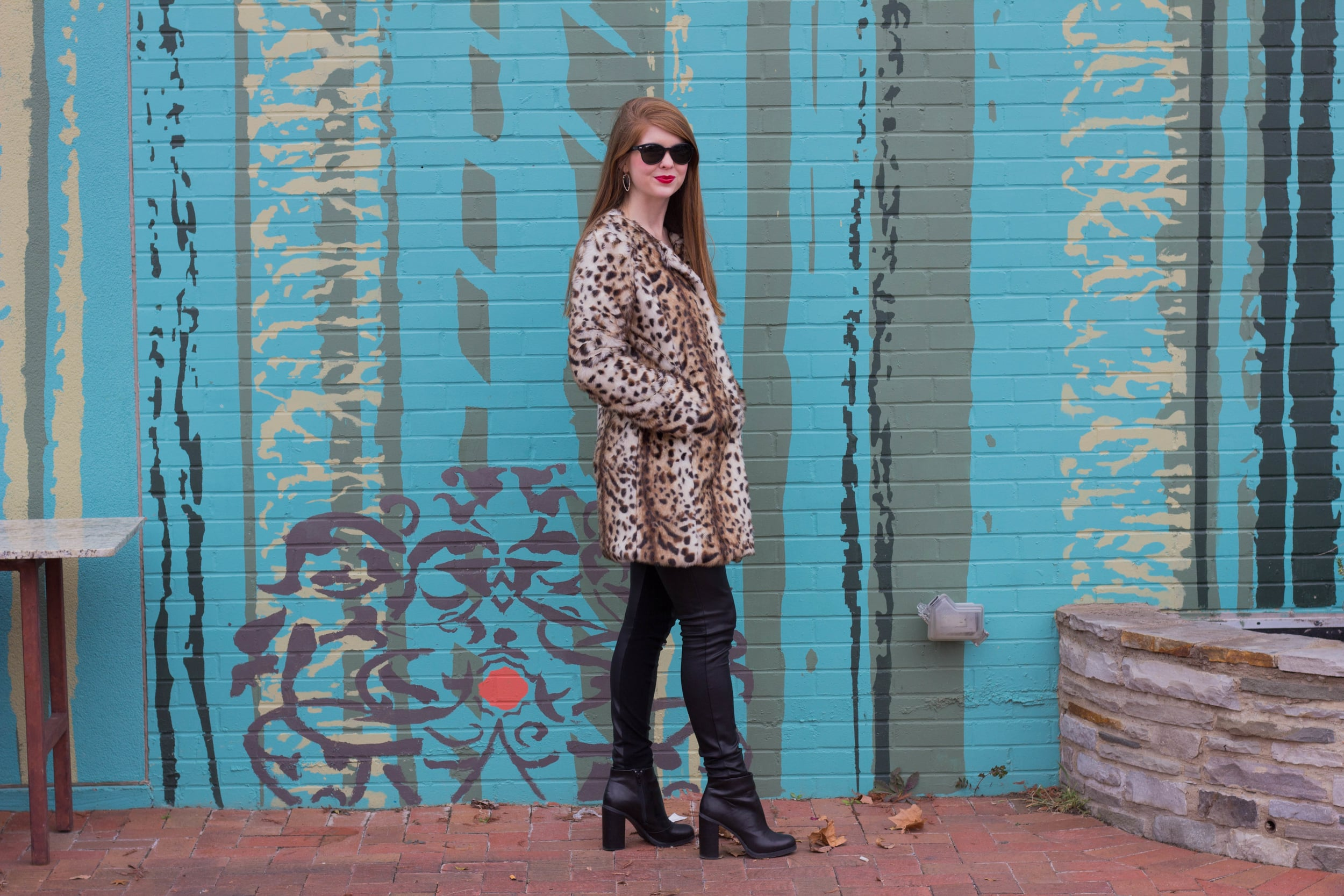 leopard coat, leather joggers, black raybans, red lip