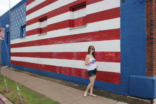 American flag mural, deep ellum, Fourth of July, white strapless top, denim shorts