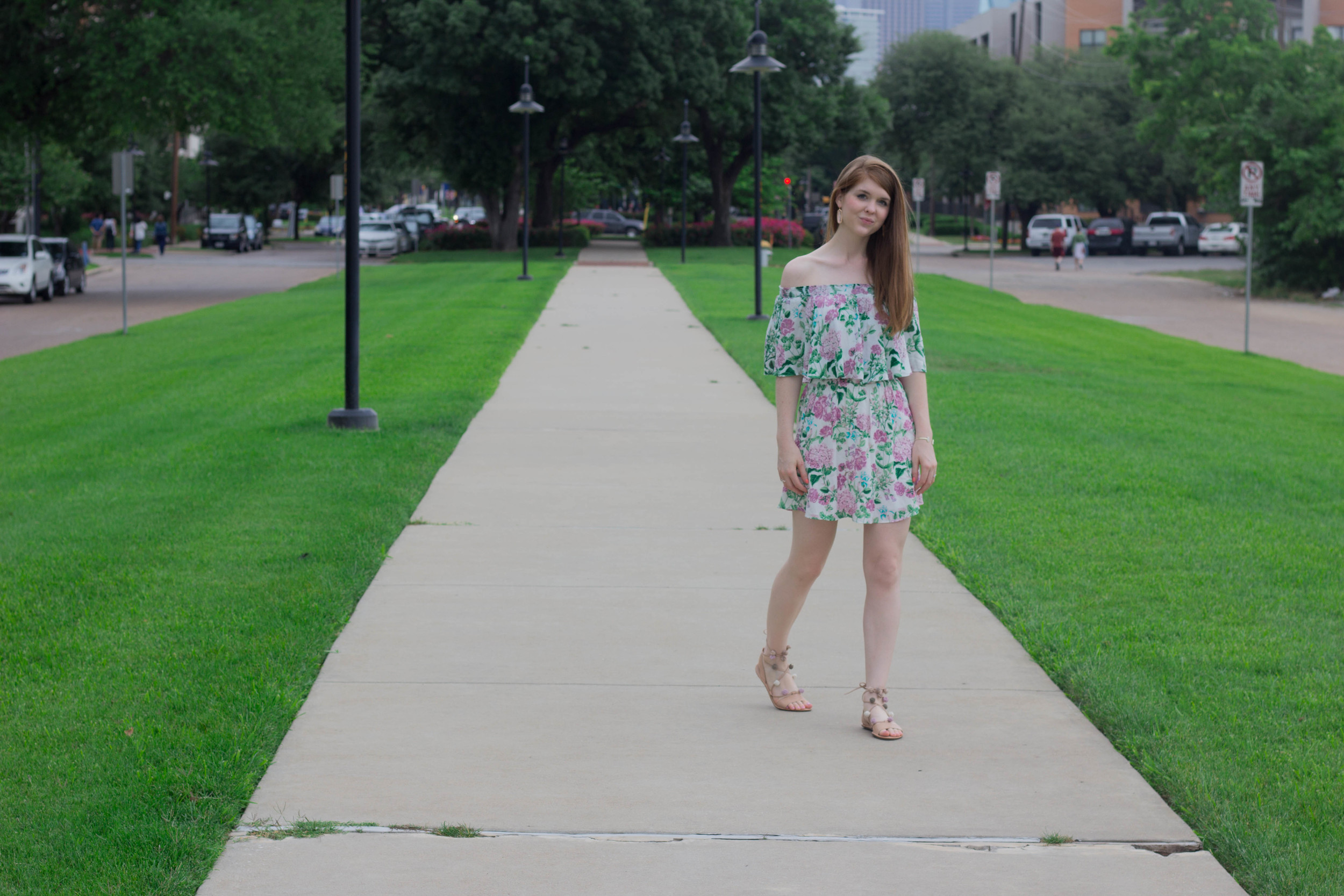show me your mumu poppies and cream off the shoulder floral dress, loeffler randall lace up pom pom sandals, kendra scott lauren earrings, dallas skyline