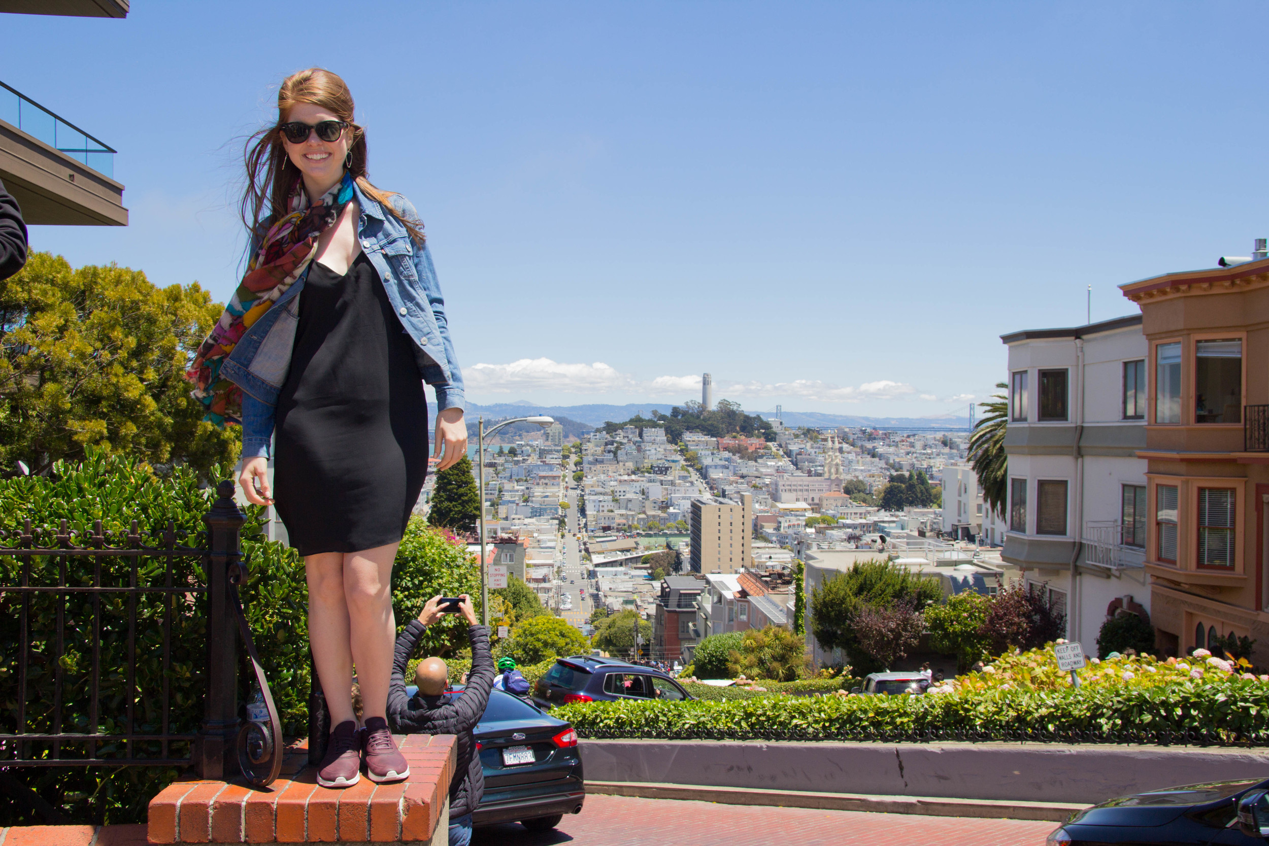 lombard street, san francisco, california, topshop black strappy dress, nike airmax thea, leather tennis shoes, levis denim jacket, rounded rayban, floral scarf, gold cuyana carryall. what to wear to san francisco, the perfect tourist outfit