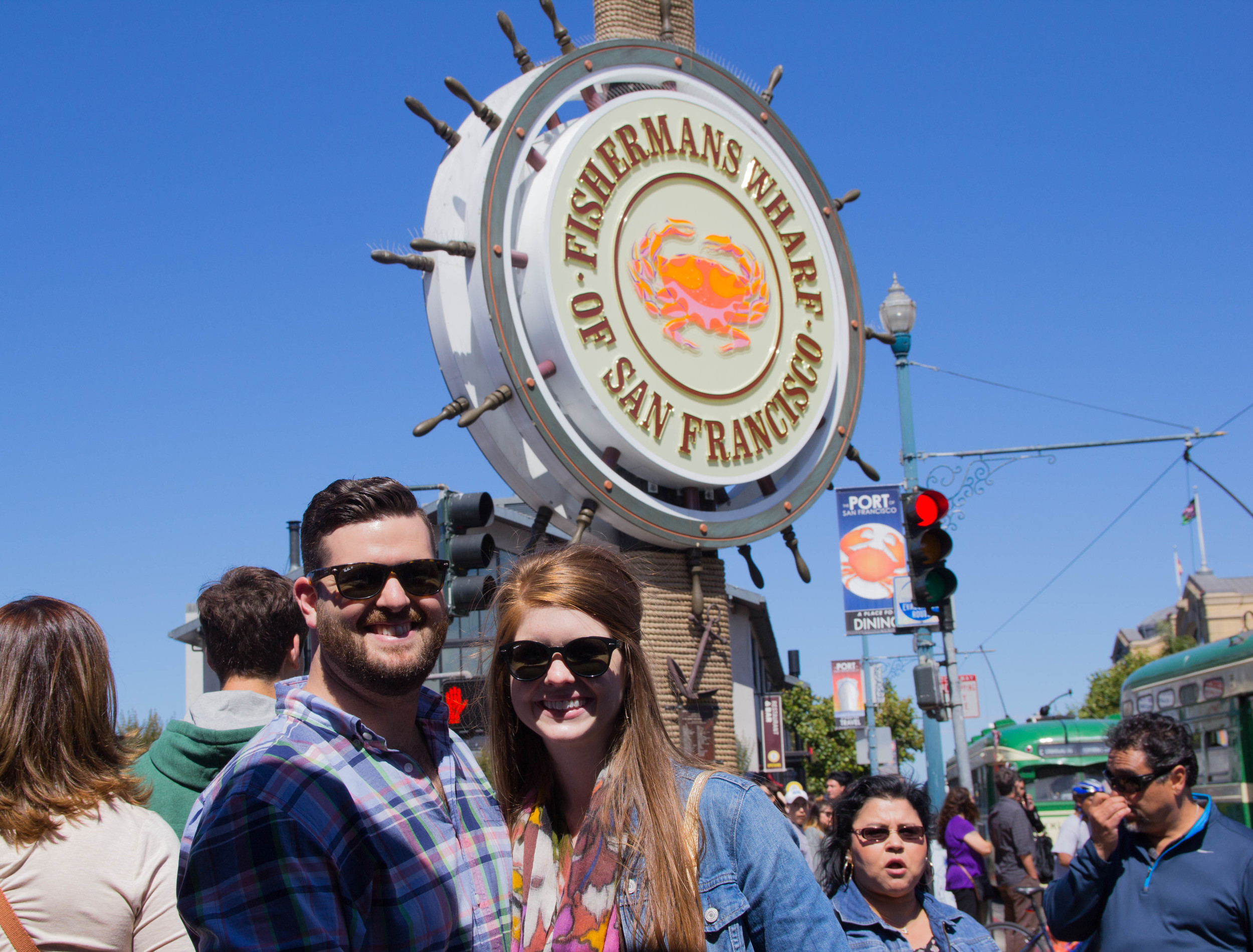 fishermans wharf, san francisco, california, topshop black strappy dress, nike airmax thea, leather tennis shoes, levis denim jacket, rounded rayban, floral scarf, gold cuyana carryall. what to wear to san francisco, the perfect tourist outfit