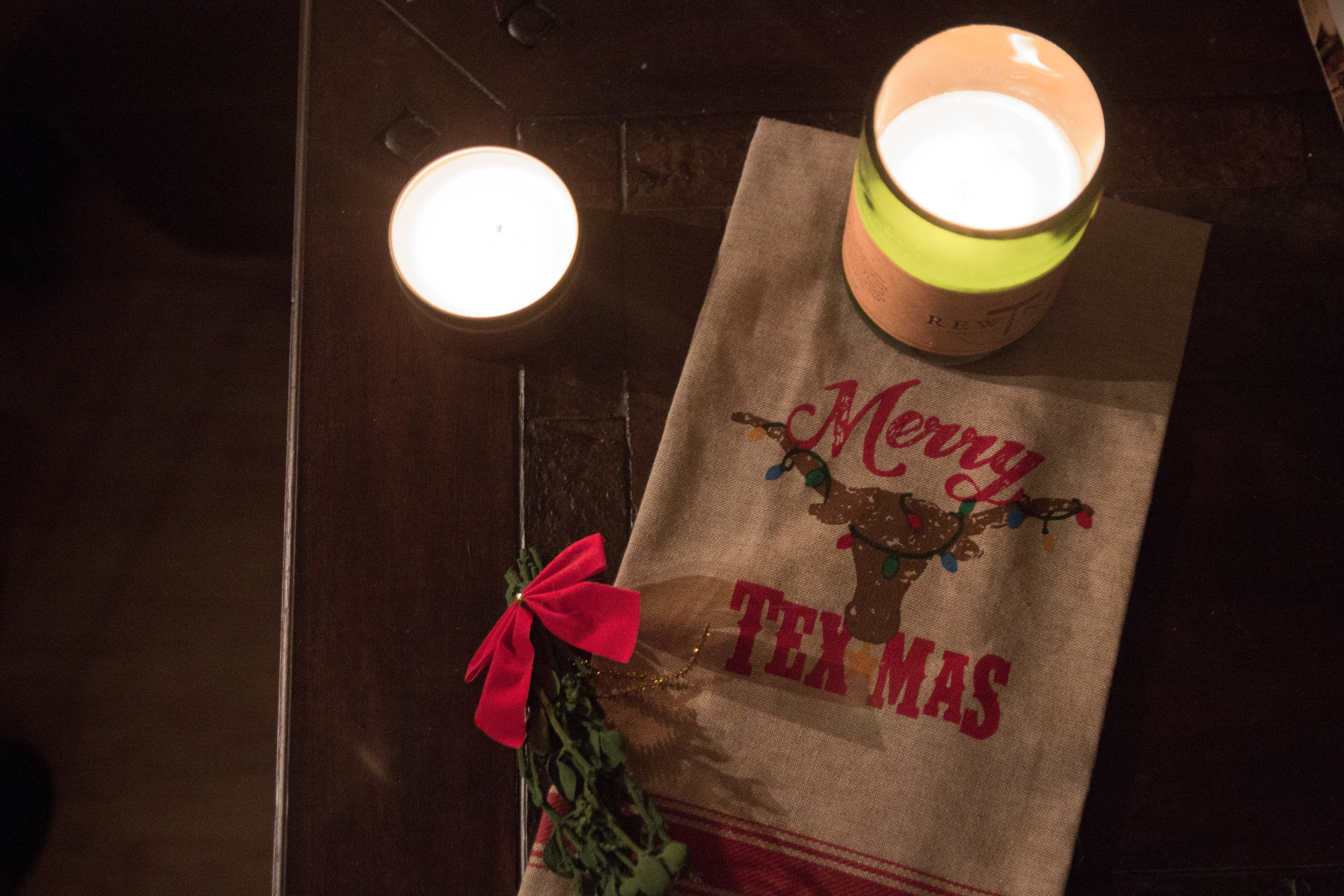 the best holiday candle scents, how to keep that holiday feeling, well after christmas, nest holiday candle, rewined wine under the tree candle, benjamin soap co. pumpkin spice candle, merry texmas