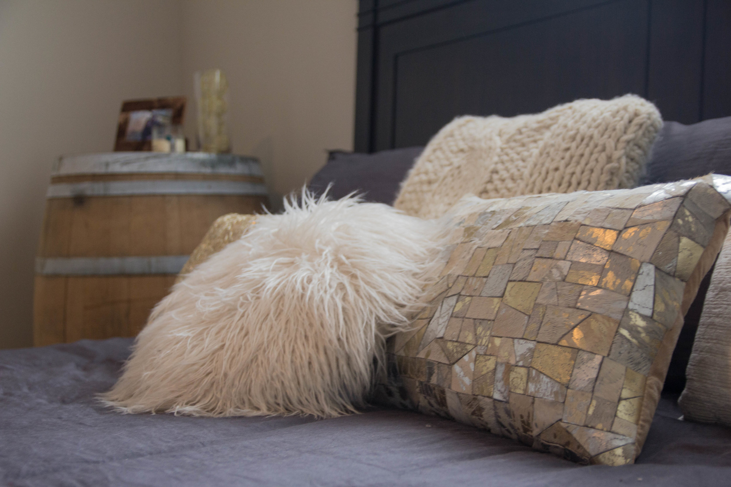 Sharing an Apartment: How to Combine Décor Styles, wine barrel decor, rewined candles, grey, cream, gold, metallic faux fur rug, mongolian faux fur rug, parachute bedding, tuft and needle foam mattress,  dallas sky lofts, apartment locater service