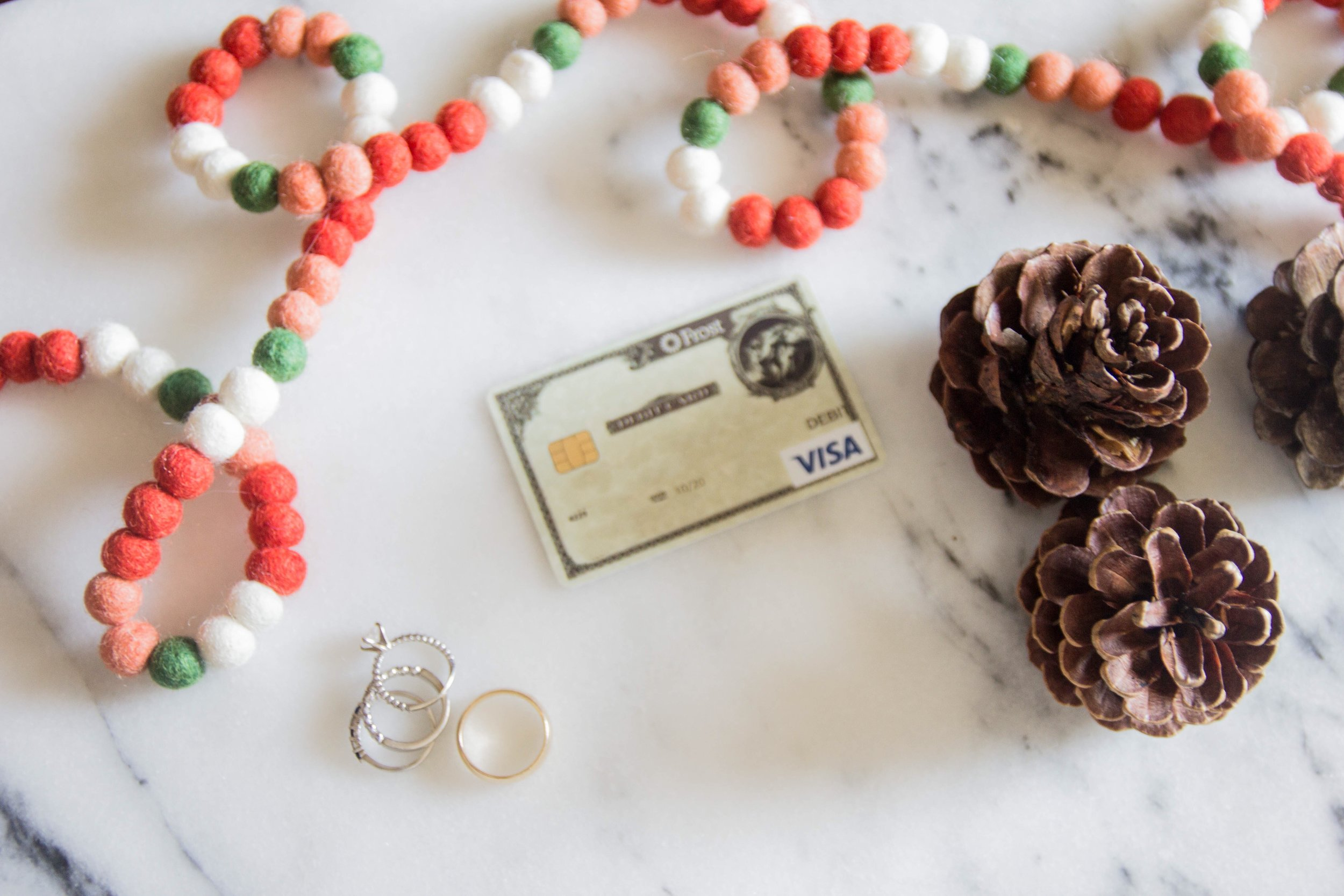 frost bank, navigating finances, minted felt garland, crate and barrel stockings, cinnamon pinecones