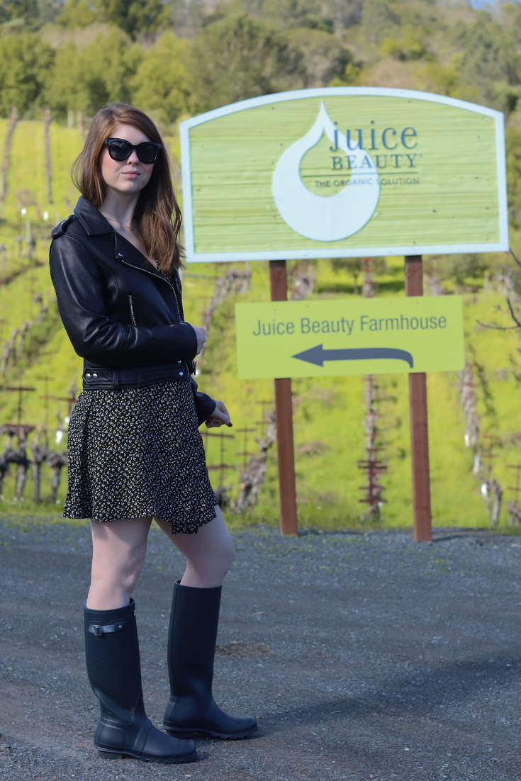 juice beauty, farm, sonoma, healdsburg, clean beauty, nontoxic beauty, skincare, green, madewell button wrap dress playground posies, blanknyc leather jacket, tall hunter rain boots, black oversized sunglasses