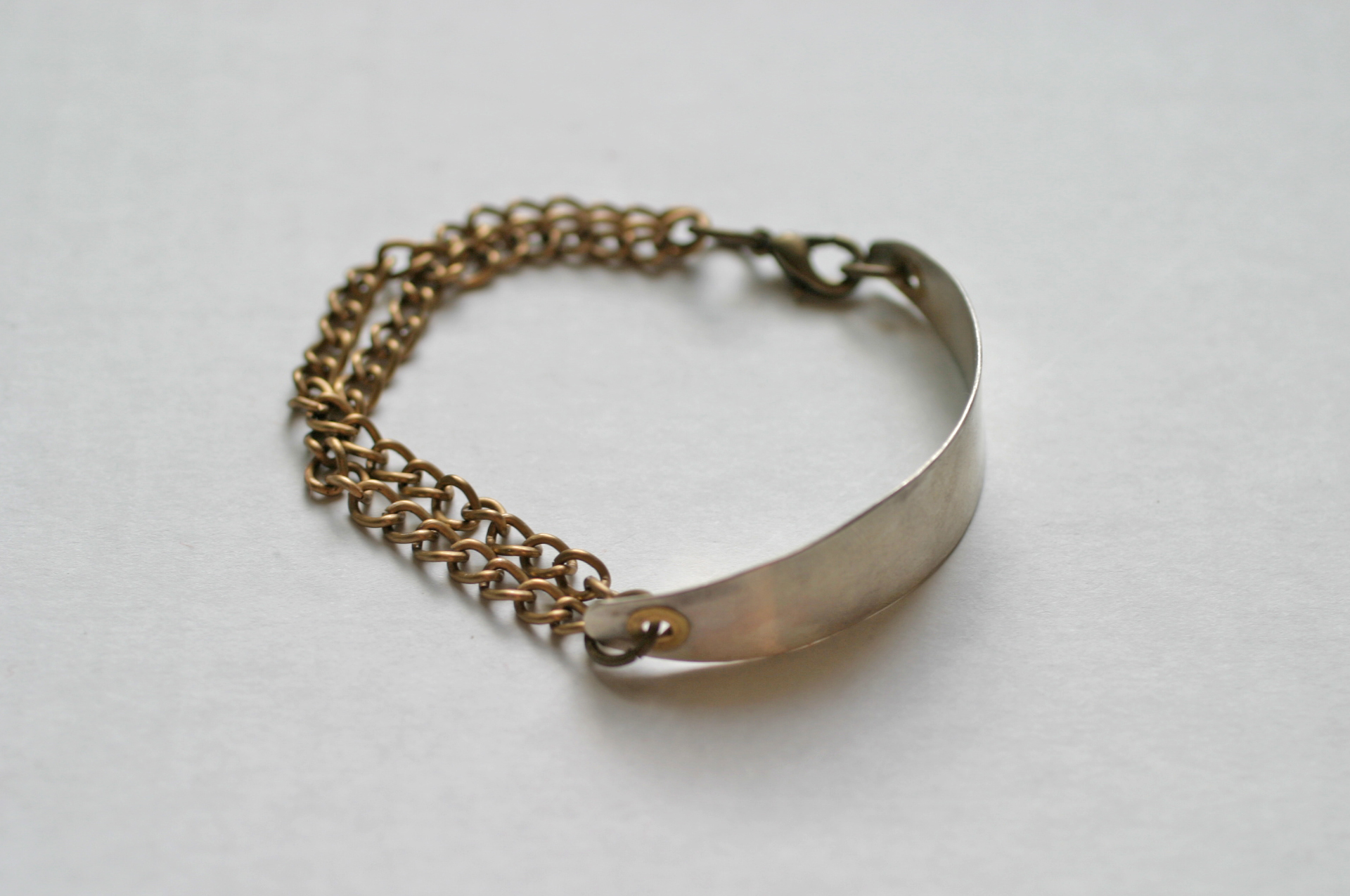 Elizabeth Baird Architecture-Jewelery-silver and brass chain bracelet.jpg