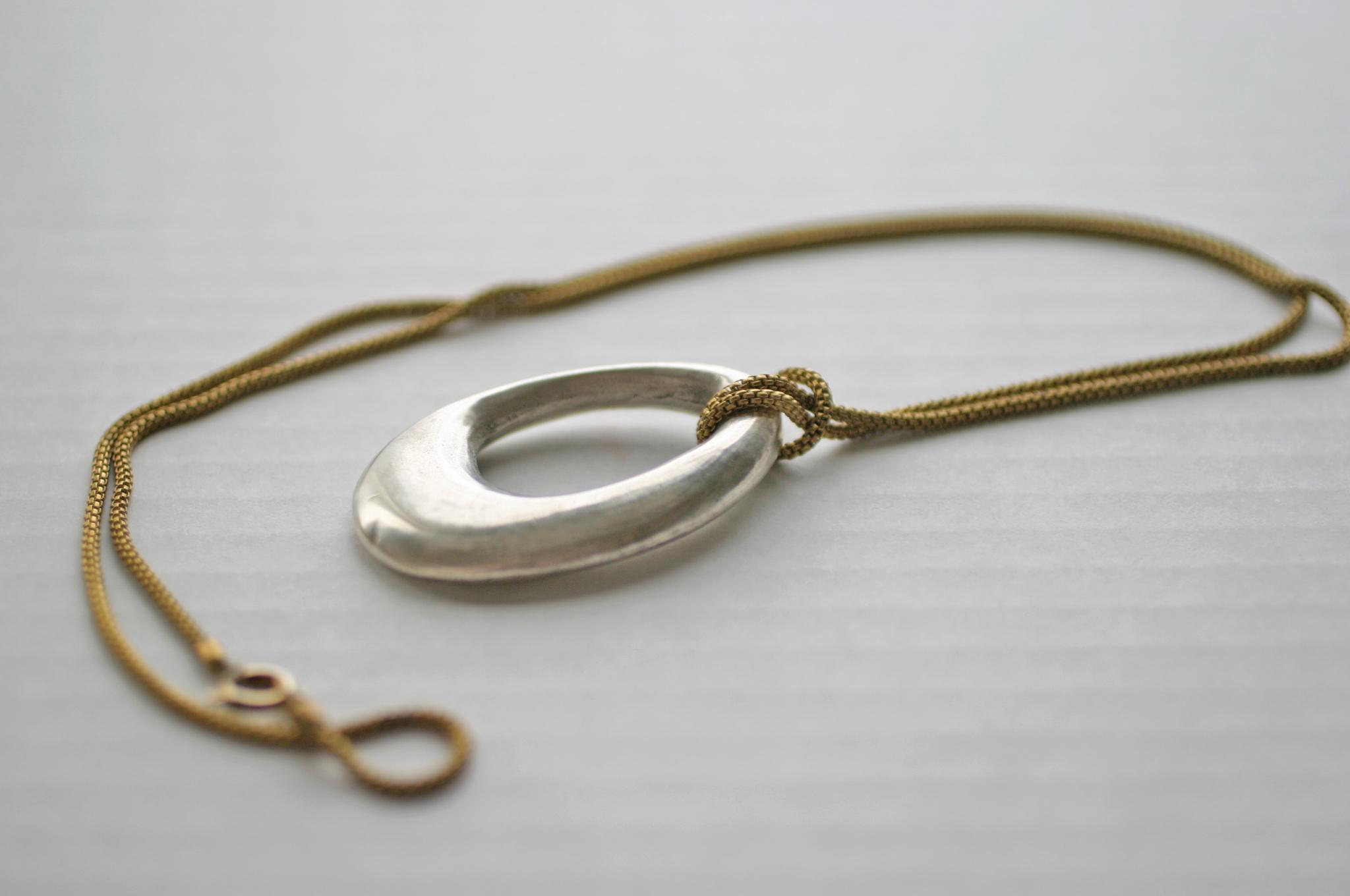 Elizabeth Baird Architecture-Jewelry-cast silver pendant.jpg