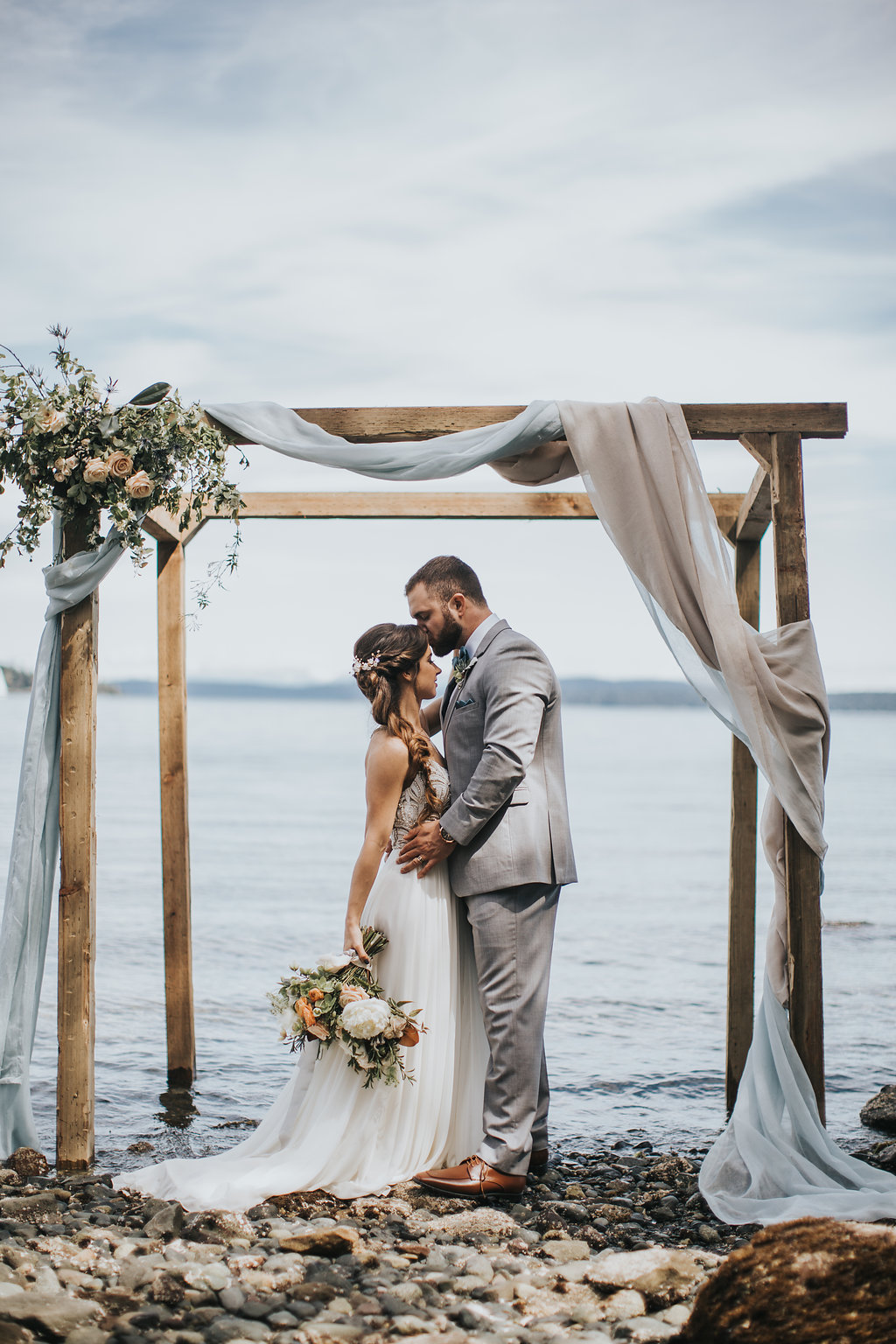 Vancouver-Island-British-Columbia-Beach-Wedding-Ocean-Ceremony-Neutral-Arbour-Romantic-Peach-Bouquet.jpg