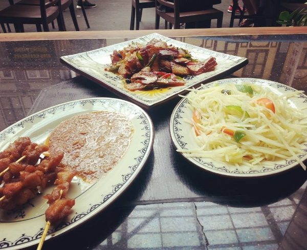 Chinatown's Food Street is a must for the tourists - sit, drink, eat your way through the day. This is from a Sichuan restaurant - chicken satay, potato stir fry and spicy pork stew.