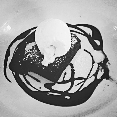 Chocolate brownie with hot fudge sauce and a scoop of vanilla ice cream.