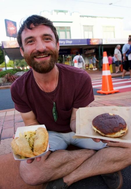John with his empanadas and custard-filled cronut.