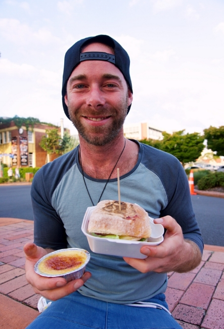 My friend, Sam, with his chicken and cranberry burger and creme brulee.