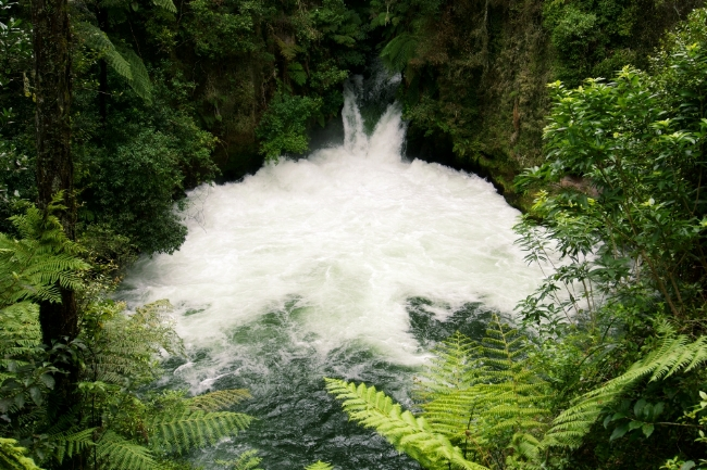 Tutea Falls - if you're lucky, you might just catch a raft coming down the waterfall.