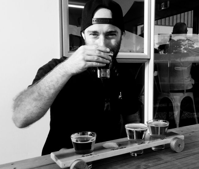 My friend, Sam, taking the first sip from his tasting tray from the Mata Beer range.