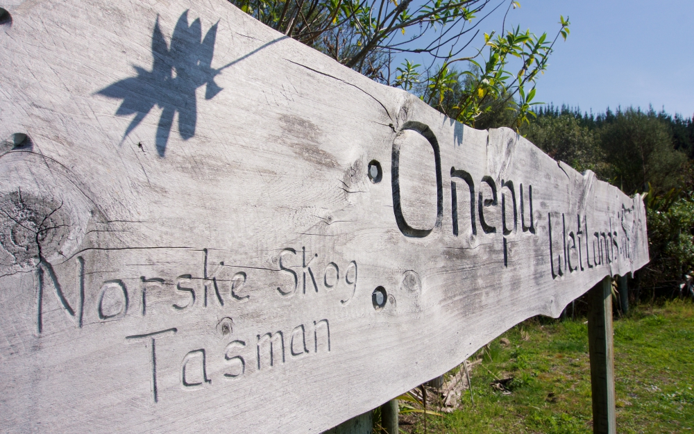 The carved wooden sign at the entrance of the wetlands.
