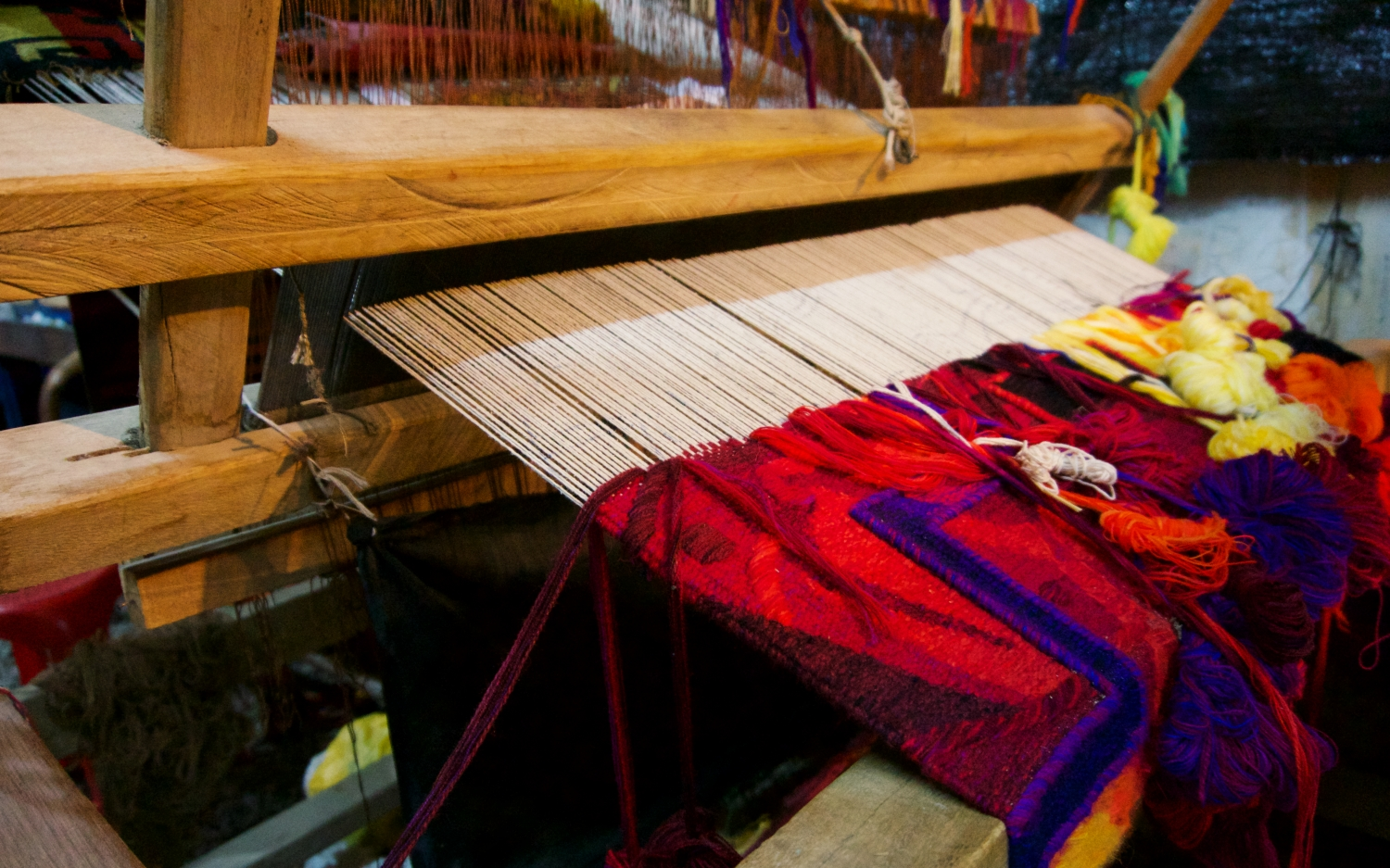 A wooden weaving loom the families used to produce rugs for sale.