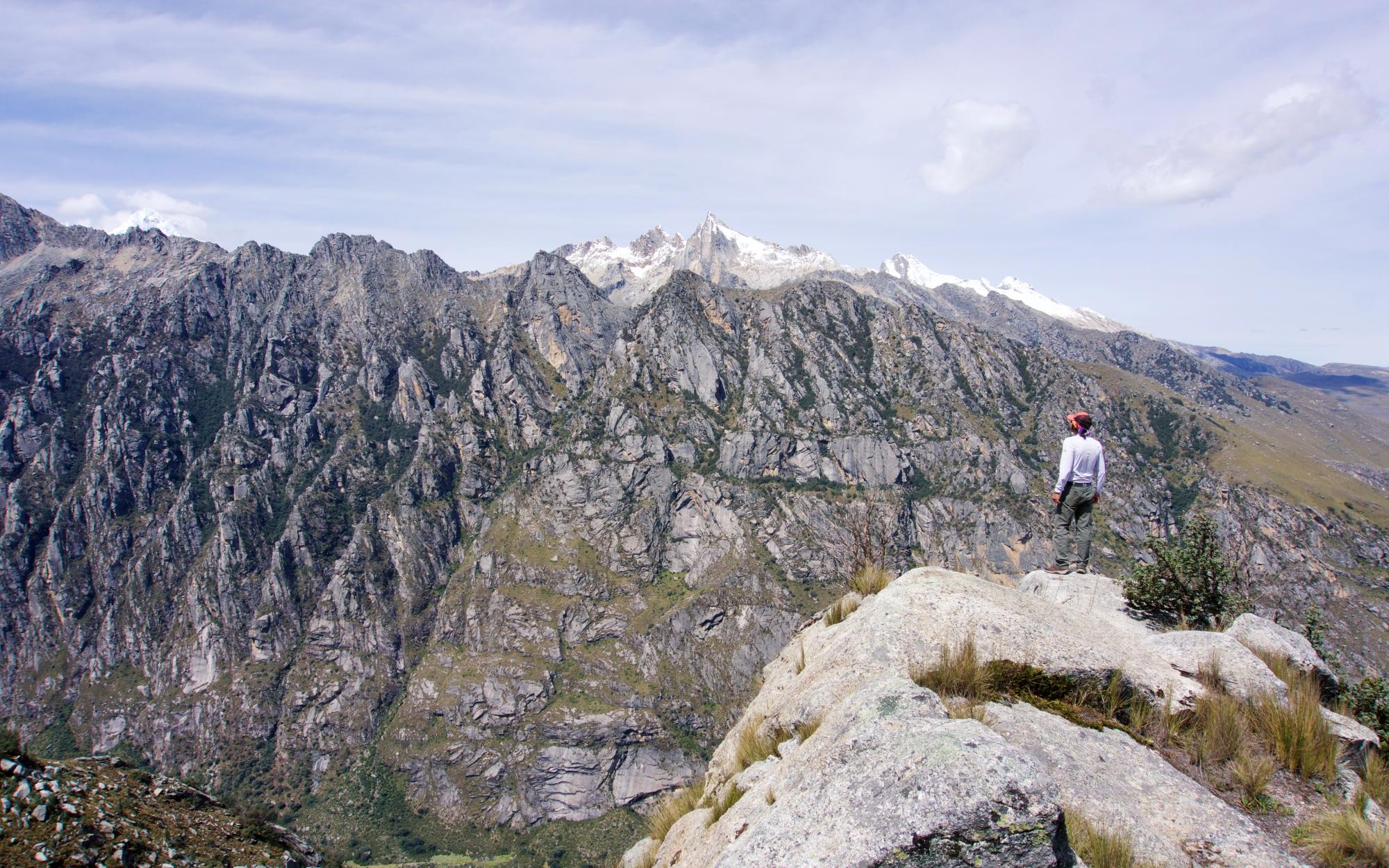Guido, a mountain guide from Casa de Guias overlooking the incredible landscape.