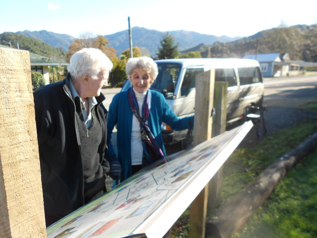 Pat Fitz & Phyl Stuart looking at an information panel on the history of Blackball