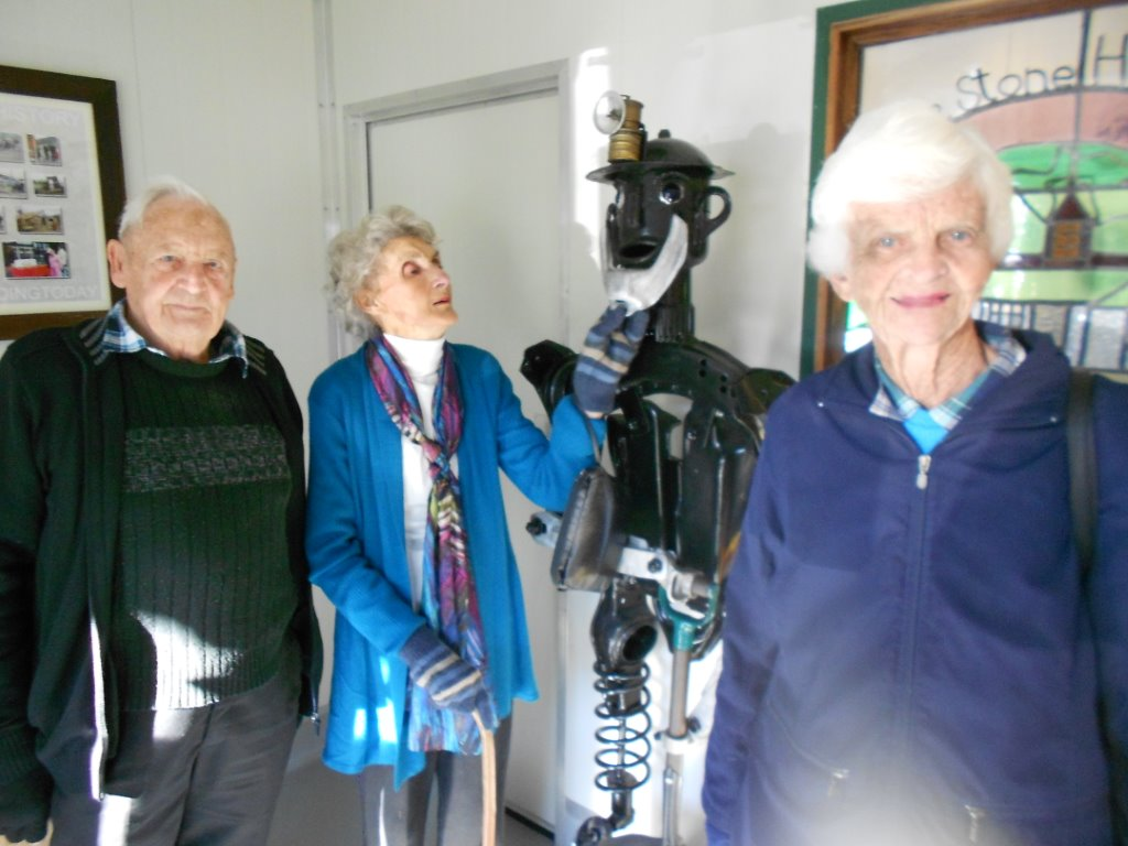 This photo is of Trevor Chapman Phyl Stuart & the Blackball coal miner made from scrap metal/and Pauline Burling