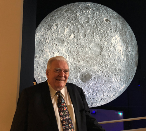 Mike Dinn in front of a 7 metre diameter lunar globe at Questacon science centre in Canberra, 23rd November 2018.  Photo by Colin Mackellar.