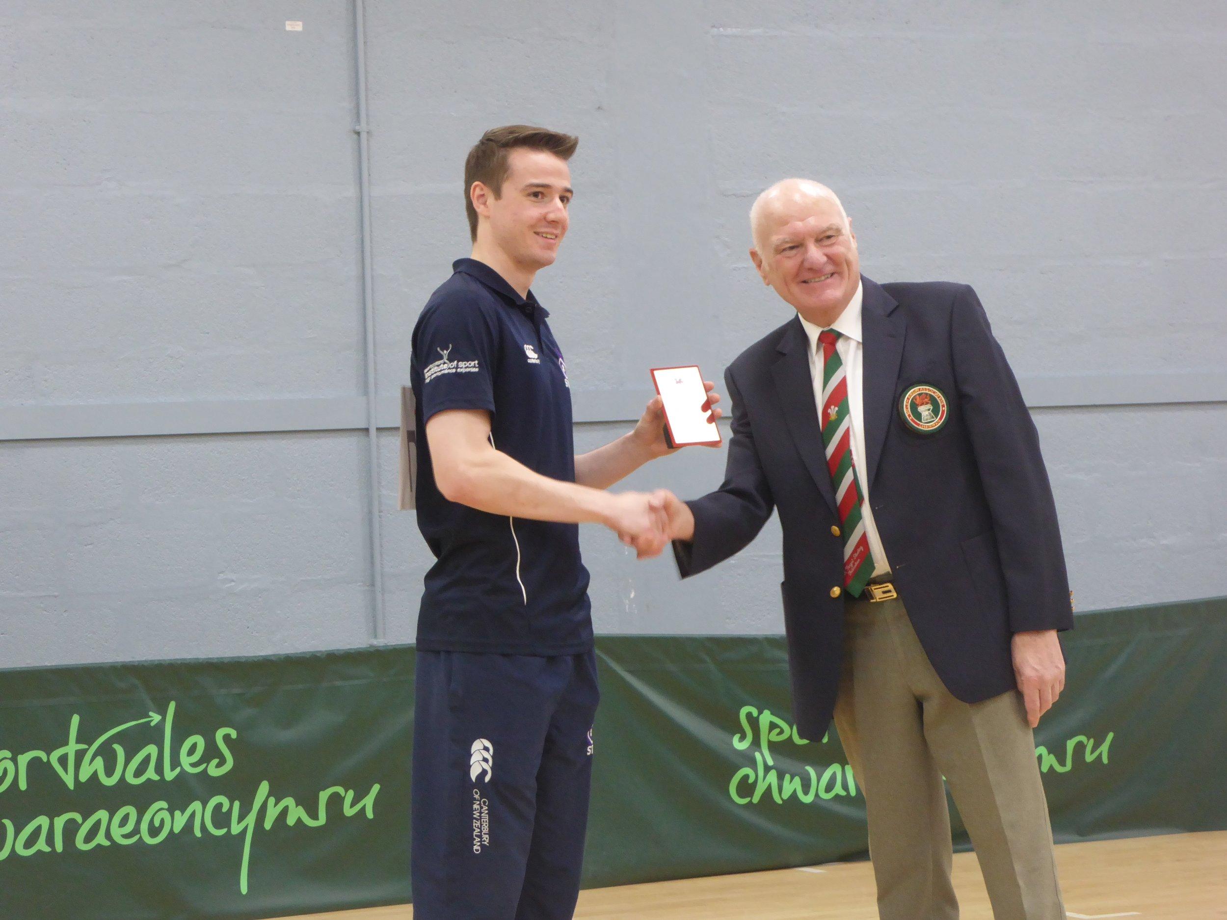 Aedan Evans receiving his Gold medal
