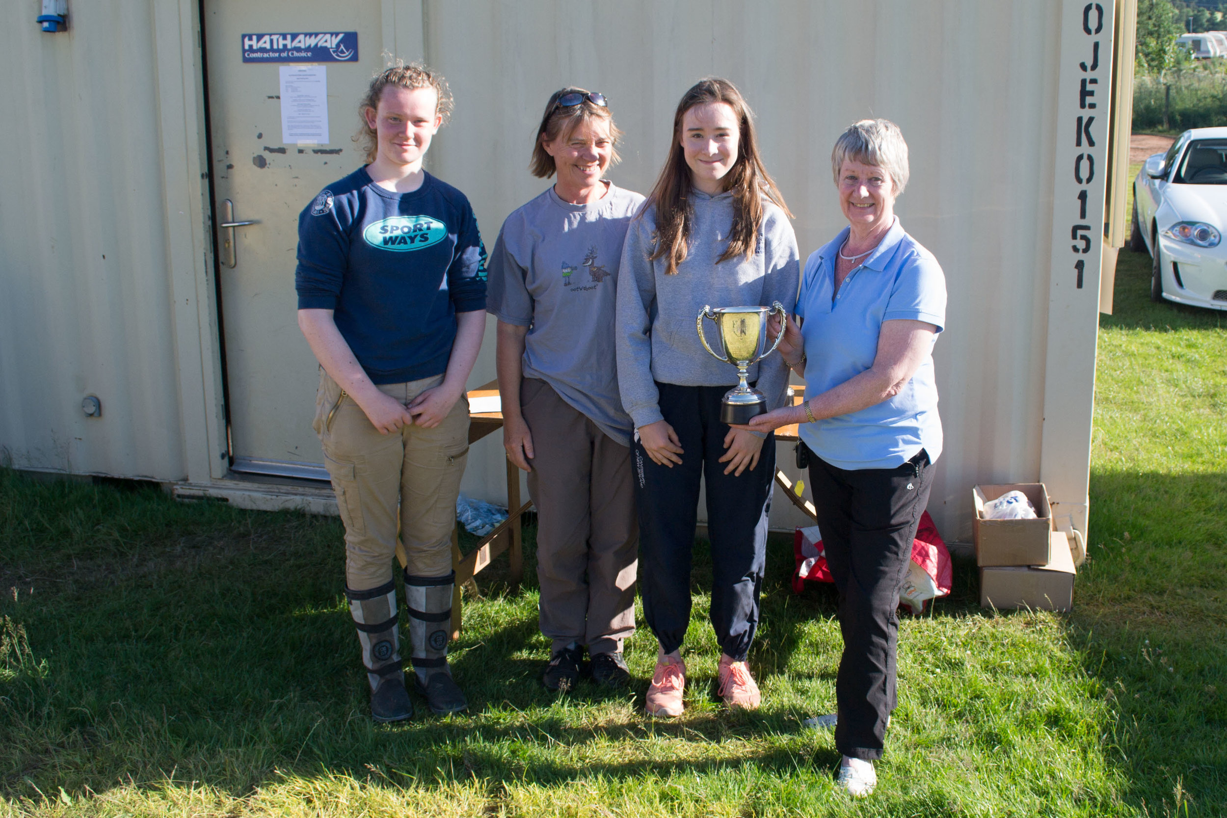 Sheena Sharp presents the Trophy to the successful team from George Watson's College