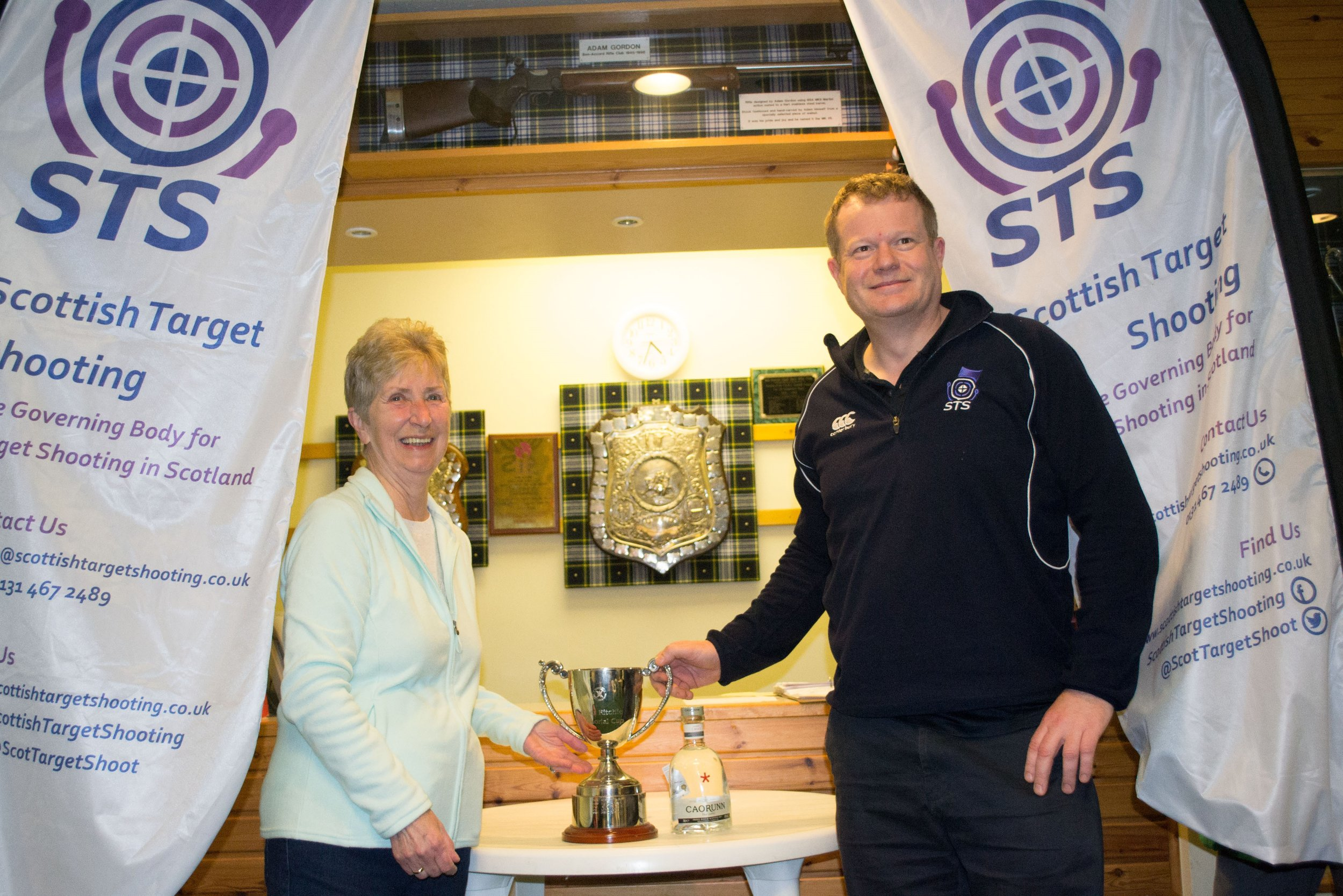Margaret presenting Alan with the winner's cup and Gin