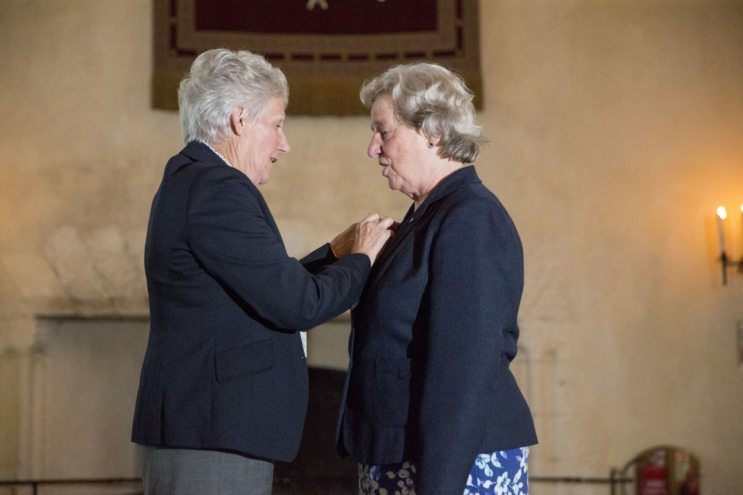 Joan receiving the CGF order of Merit from Louise Martin CBE, President of CGF