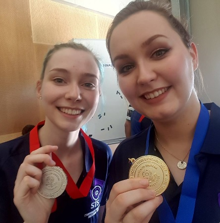 Jennifer & Seonaid McIntosh celebrating with their Gold & Silver medals from the 50m Prone Rifle CSF Competition