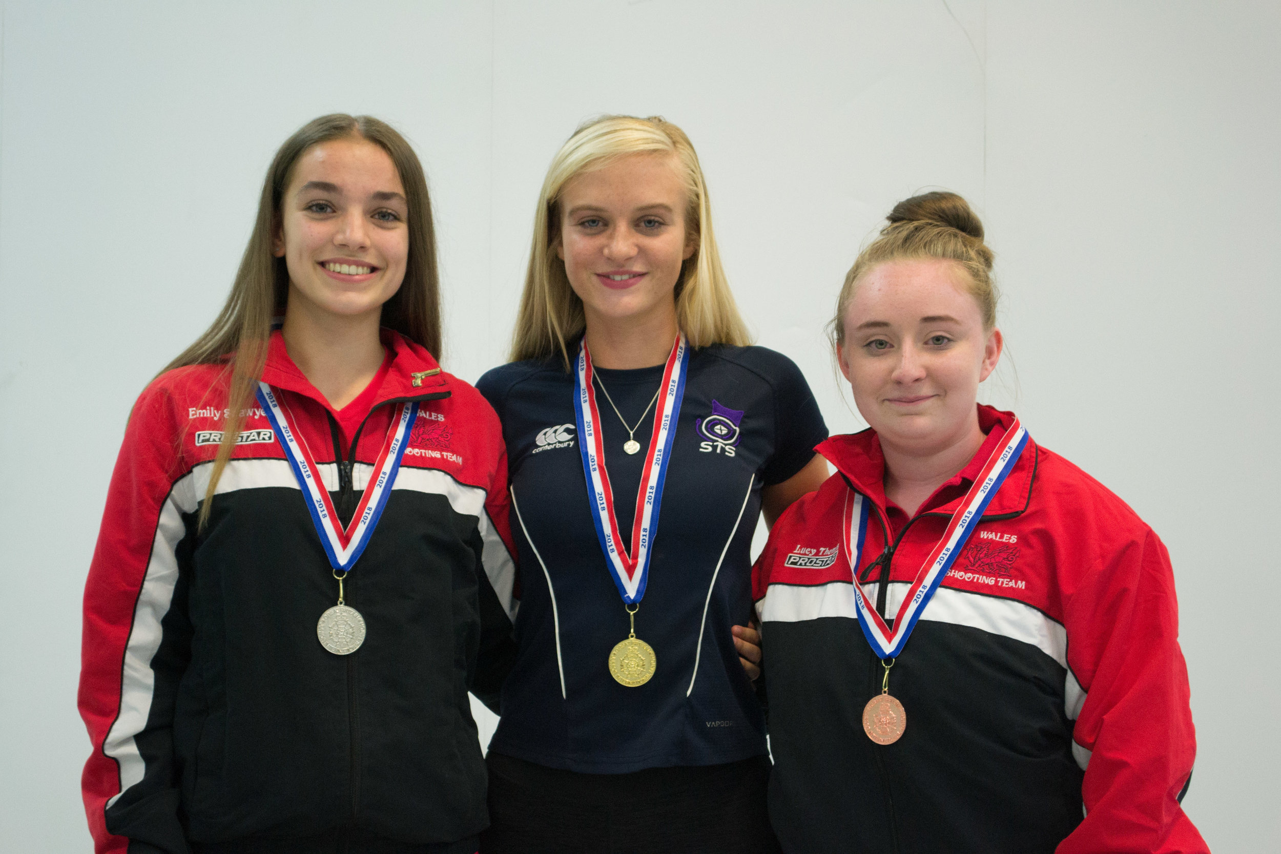 Katie, flanked by Welsh shooters, won Gold with a score of 555