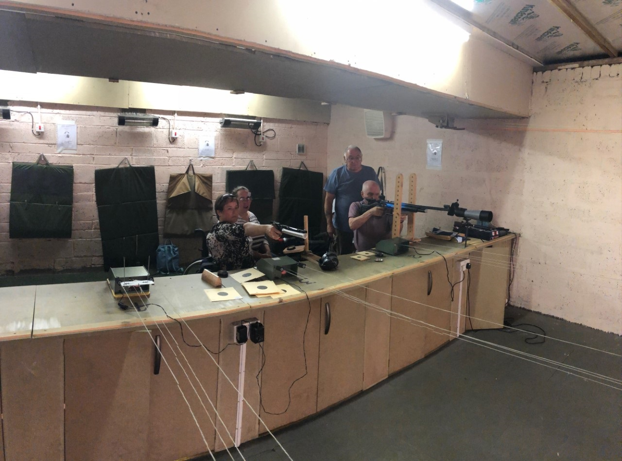 Aileen and Michael under the watchful eye of Bronwen and coach Willie at the Alloa and District Rifle Club