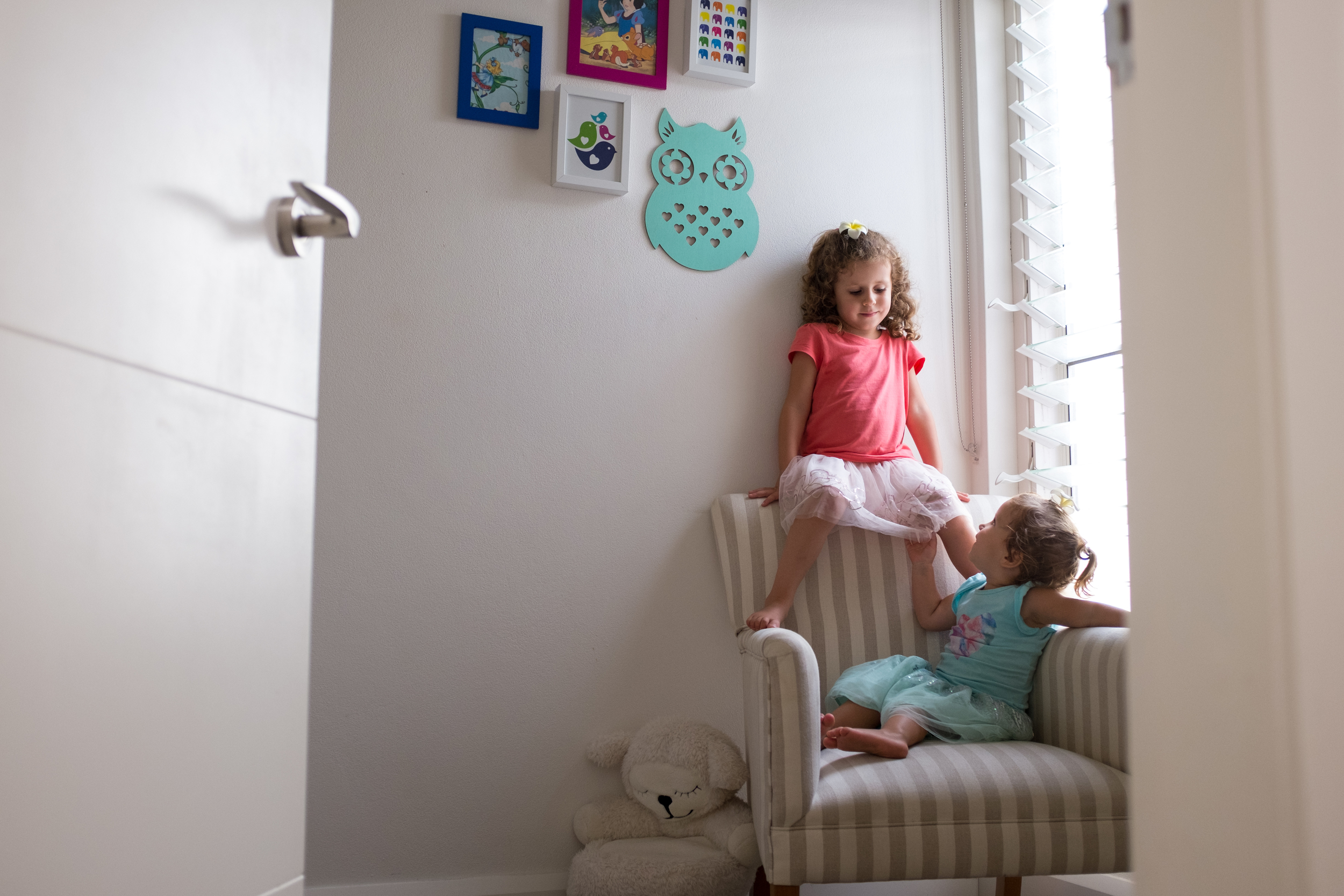 """Using the """"Baby Room"""" for gymnastics. Climbing on the chair and jumping in the cot."""