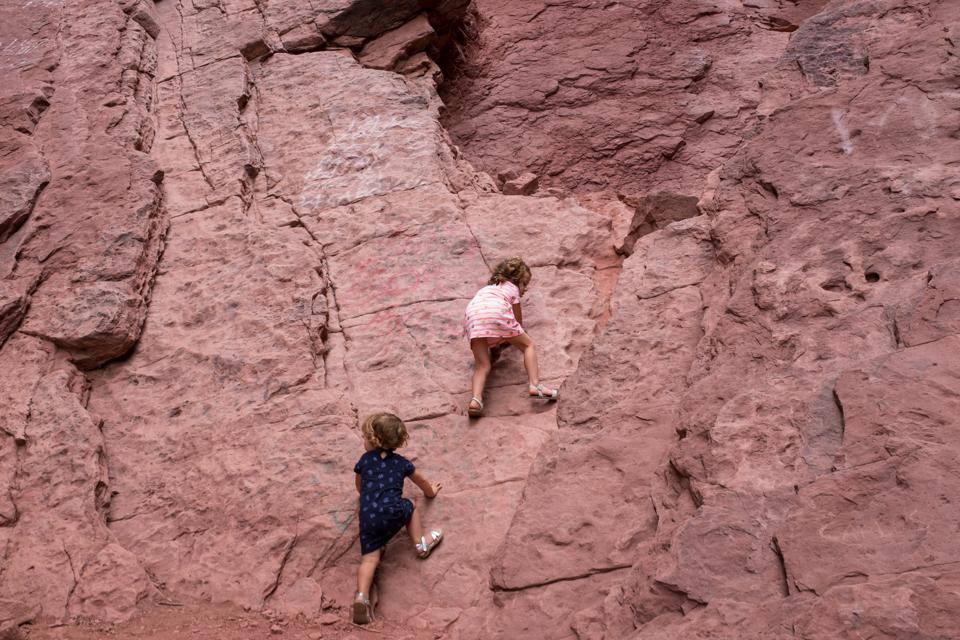 Two rock climbing monkies at the Devils Throat in Quebrada de Cafayate