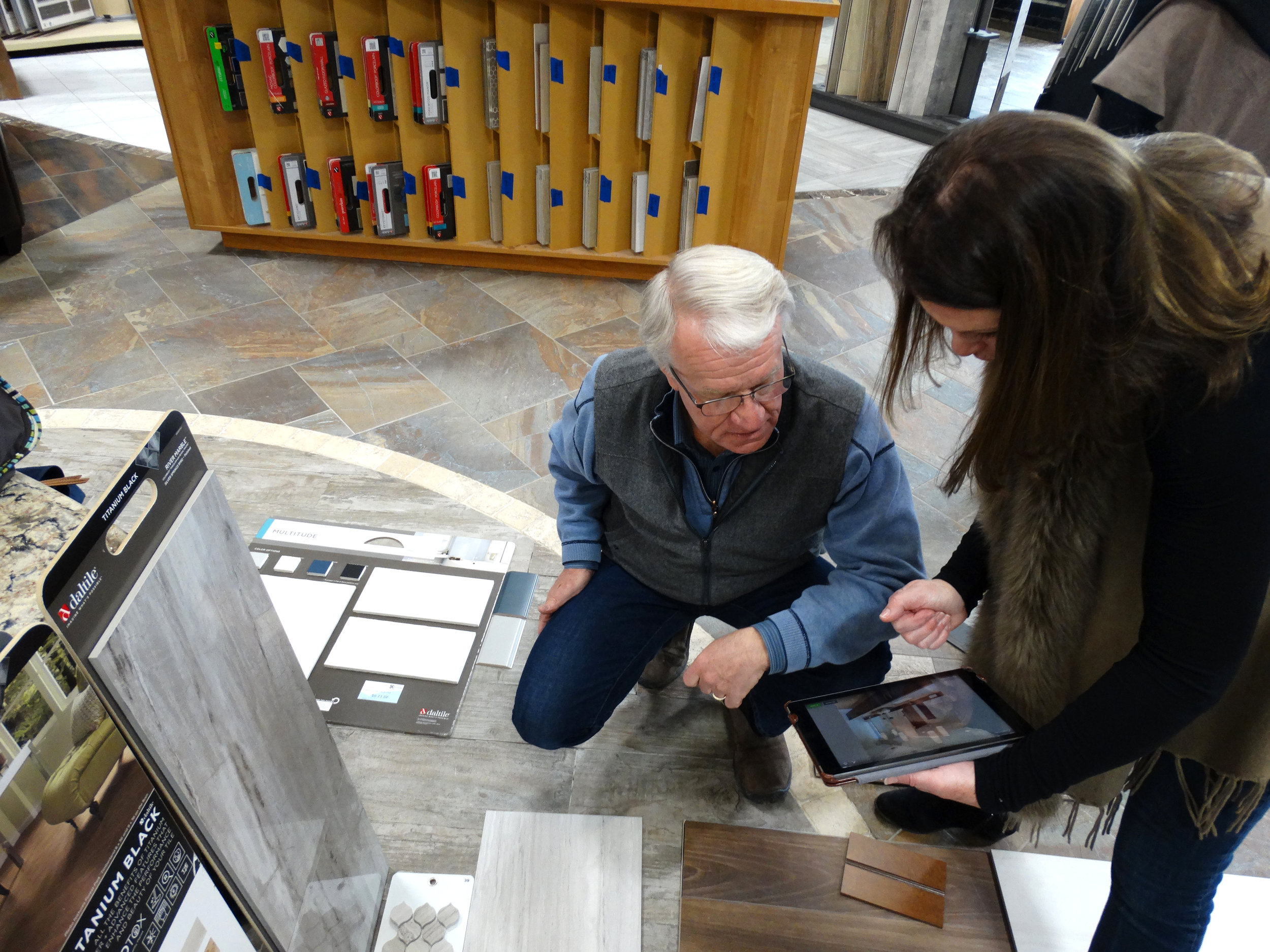 Jim and Maureen looking at samples of flooring and tile.