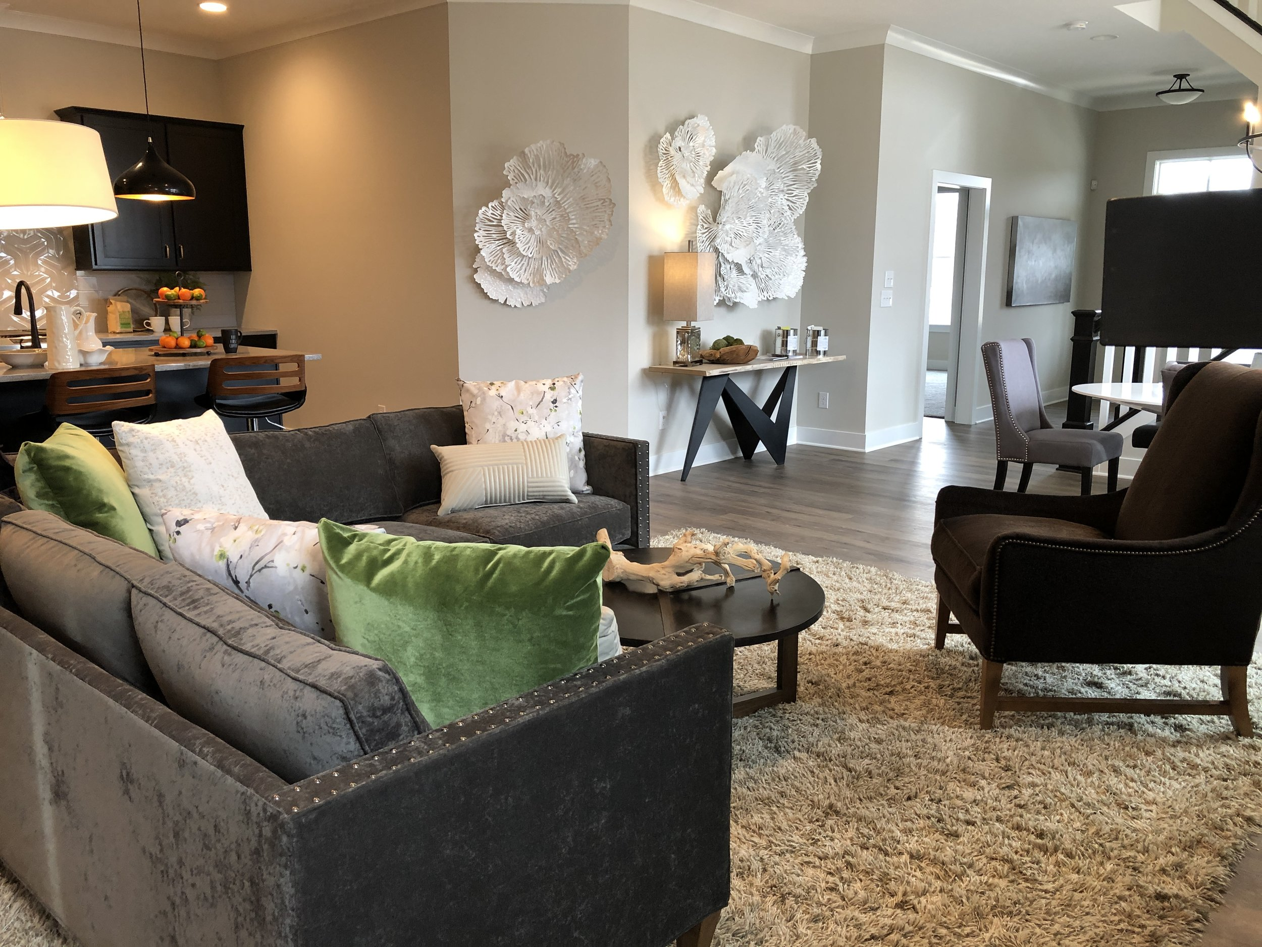 The living room of our newest model,  the Sycamore , features a variety of textures.