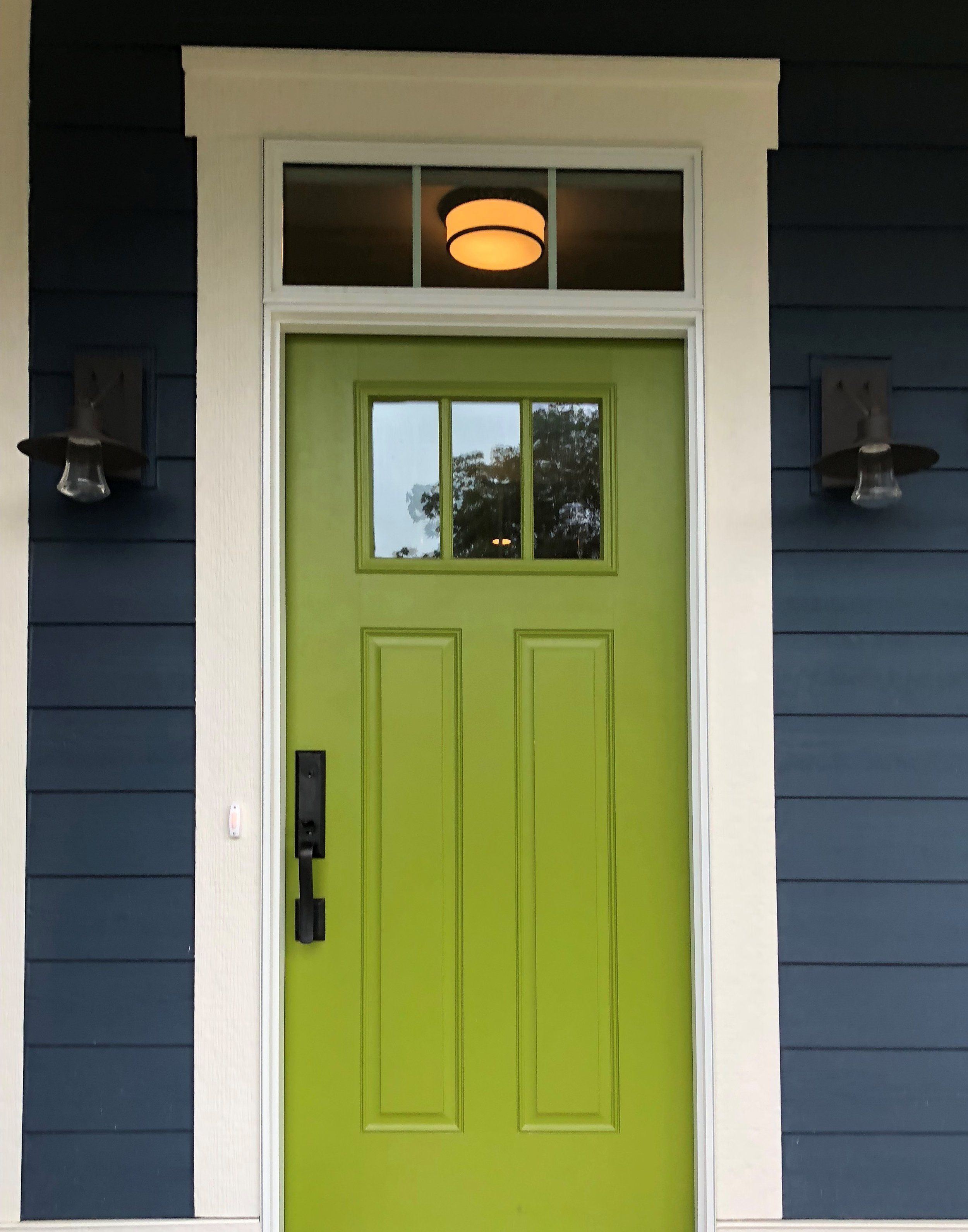 Need a pop of color to brighten dark siding? Consider a bold green or yellow.