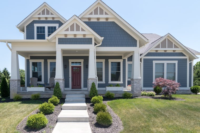 Blue custom home in Indiana with landscaping.jpg
