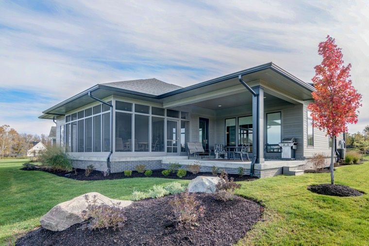 A sun room is a great way to enjoy the serenity of a golf course view -- even in the winter.