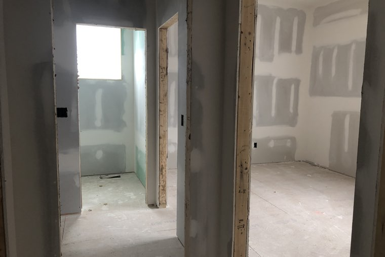 With drywall installed, now it's beginning to look like the house you designed.