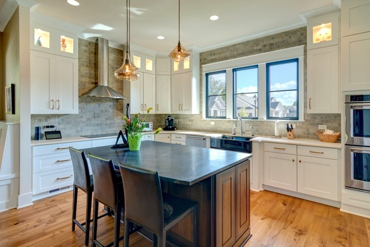 The double ovens are nice, but upgrade the kitchen island first.