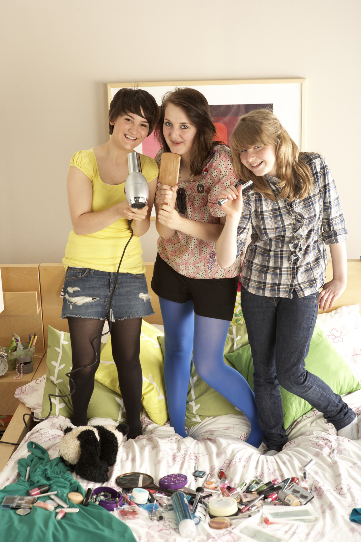 Group Of Teenage Girls Hanging Out In Untidy Bedroom