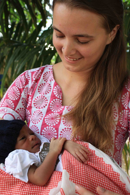 """Molly and her first solo """"catch"""", baby Mohammed, at his naming ceremony 2012."""