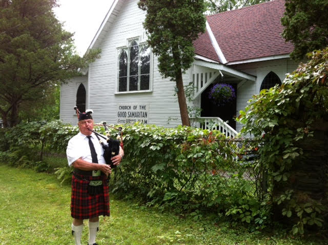 Fred Schulz pipes us out for the last summer service at Good Sam.