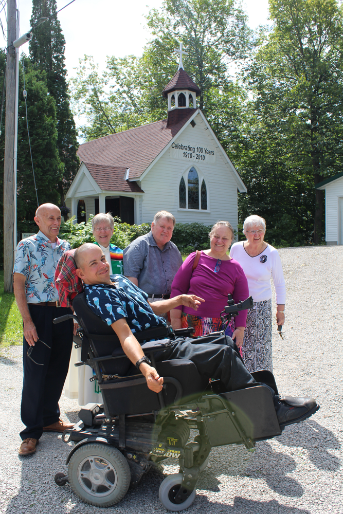 Bell tower cross dedicated in memory of Gordon Jacox Aug 25, 2019. (Left to right): David Long, Mike Long (makers of the cross), the Rev Maureen Hair, Grahame, Susan, Nancy Jacox