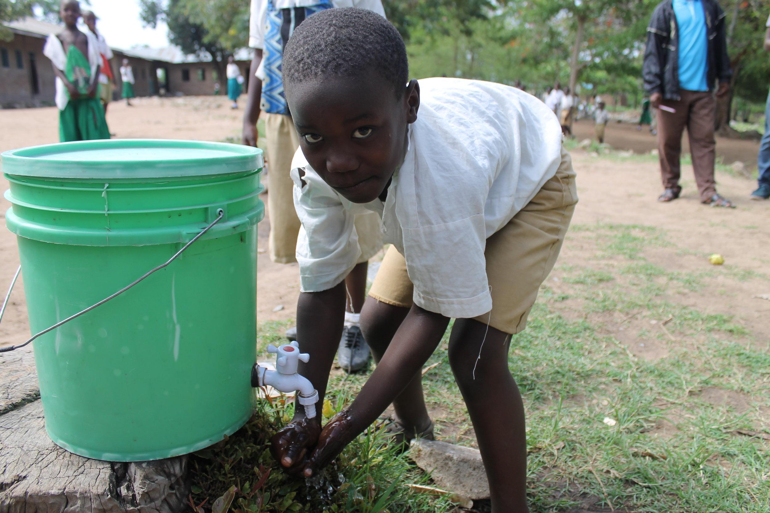 kids wash after toilet.  untreated lake water.JPG