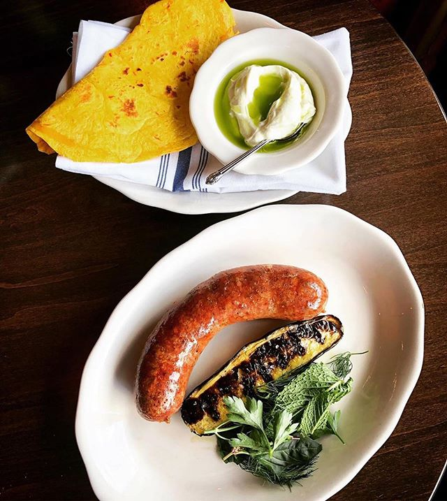 "Dang we like it when @hyacinth.restaurant brings it to another level📶 📸 ""New sausage! Spiced lamb sausage, with charred cucumber, and fresh herbs. Served with a saffron piadina, and herbed yogurt!#assembleyourself #getmessy #almostmerguez #localitalian #sandwich #flatbread #saffron #sausage @burlapandbarrel #spices #lamb #sausageparty"""